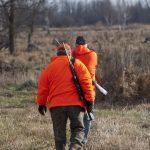 Hunters walking to hunting deer blind